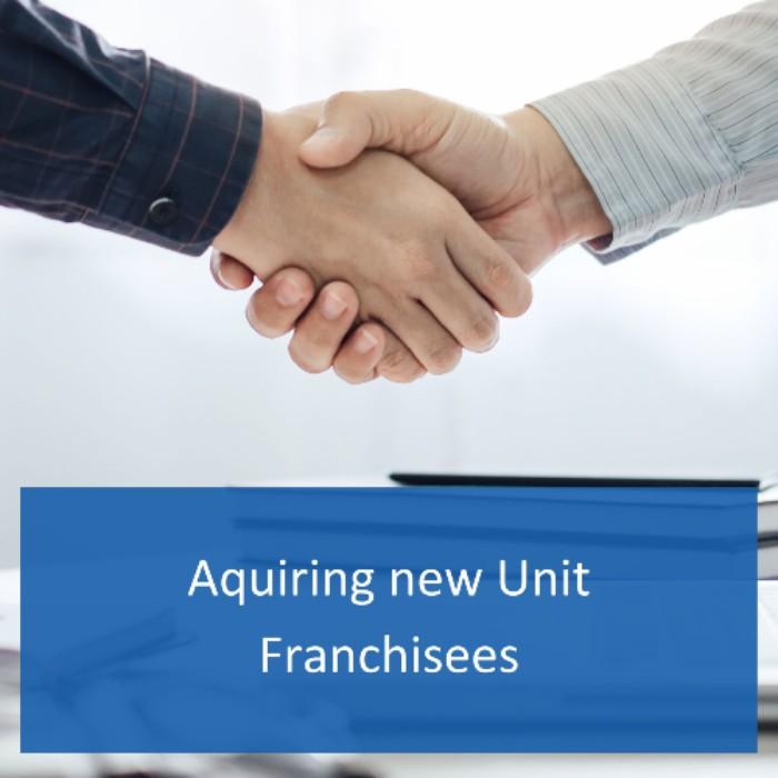 Handshake of two men closing the deal on a new unit franchise