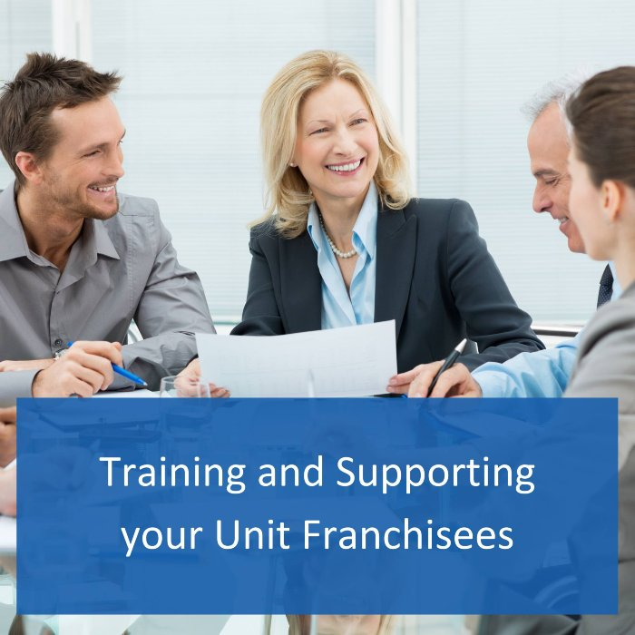 image of a board facilitator training and supporting unit franchisees